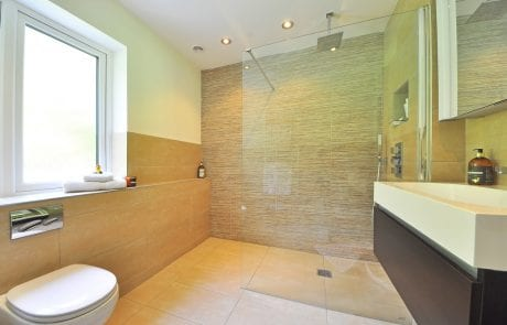 Large frosted glass pane brightening a modern bathroom