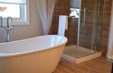 Window brightening a stand alone tub and glass walk in shower