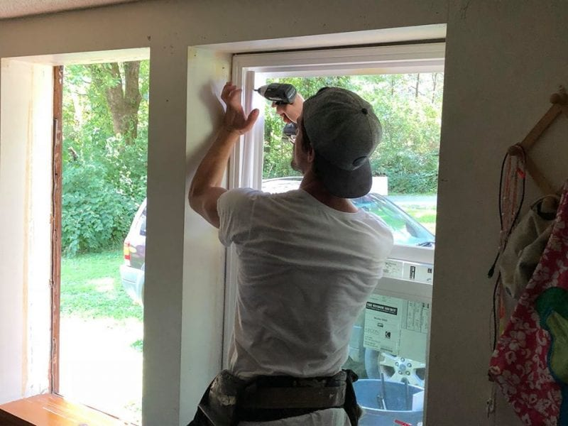 Rea Pro window specialist installing a window