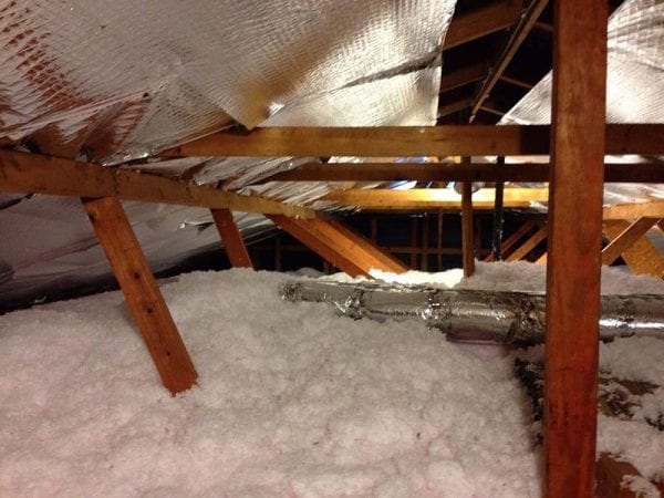 Adding insulation to attic as an energy efficiency upgrade